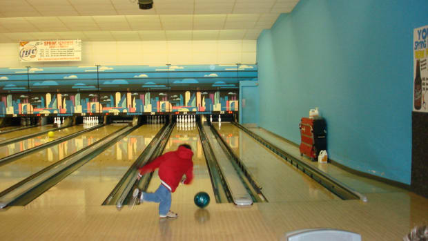 A child in a bowling alley.