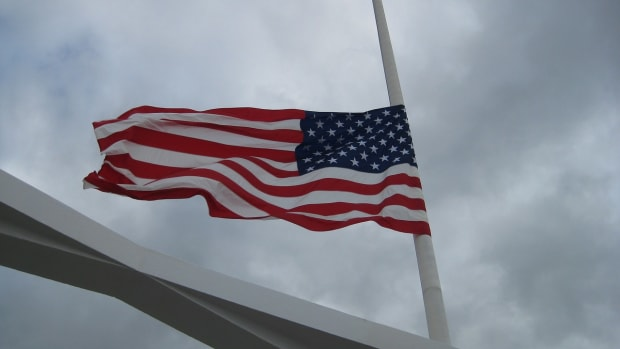 American flag at half-staff/half mast.