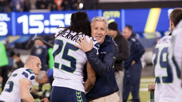 2048px-Richard_Sherman_and_Pete_Carroll_in_embrace_Super_Bowl_XLVIII