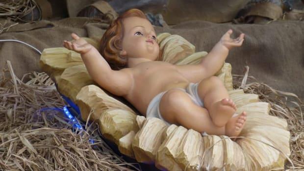 Baby Jesus/manger in nativity scene.