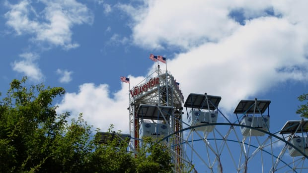The top of the Ferris wheel and Power Tower rides at Valleyfair amusement park.