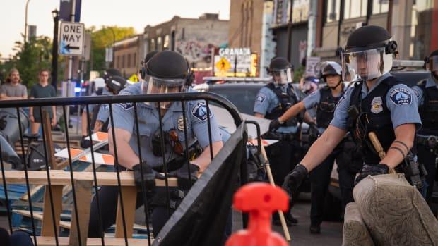 Flickr - police barricades dismantle uptown - Chad Davis