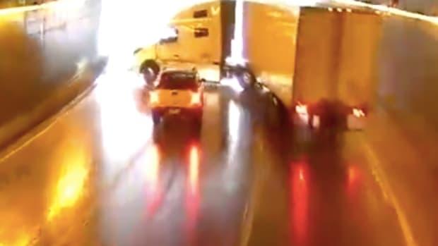 Truck jackknifes in Lowry Tunnel.