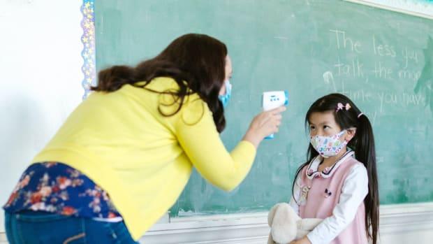 Pexels - child student school mask covid temperature