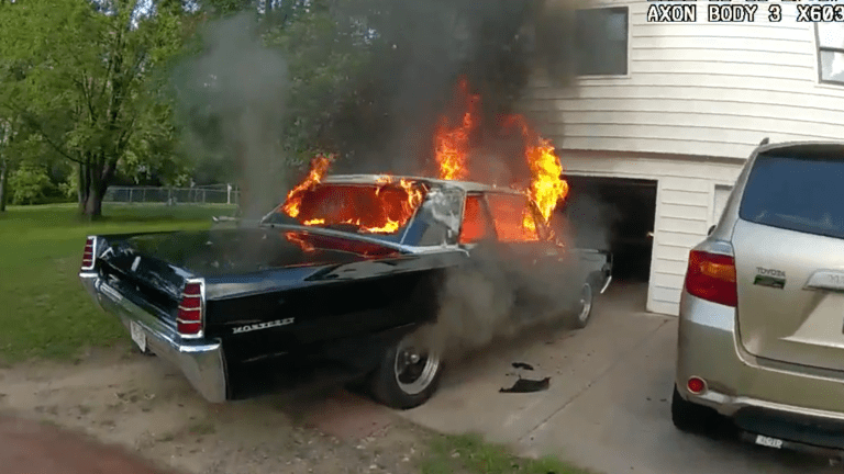 Watch: Deputy springs to action as classic car burns near house