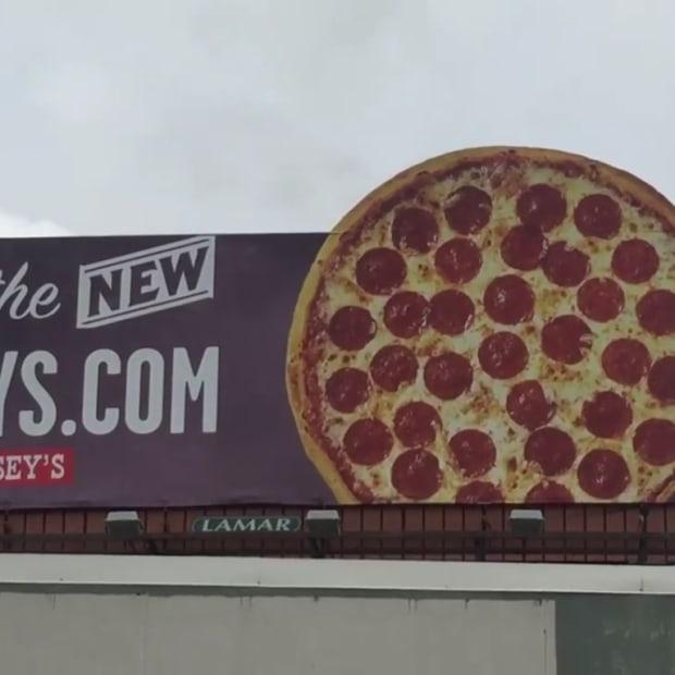 caseys-pizza-billboard-screengrab-facebook-phil-reed-kcrg