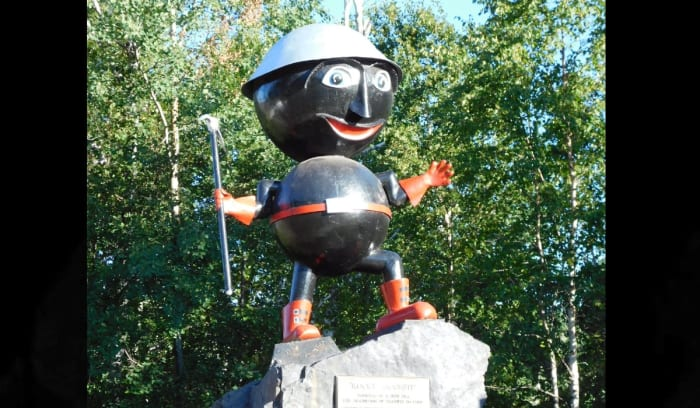 """The bulbous figure, which is made of steel storage tanks, dons a hardhat and is holding a pick atop a boulder of taconite.The statue, named Rocky Taconite, represents the industry that drew thousands of people to Silver Bay in the 1950s to mine for taconite and serves as the City of Silver Bay's mascot and a symbol of the citybeing the """"Taconite Capital of the World,"""" the City of Silver Bay's website says.The statue was dedicated in 1964, and for several years after a local woman crafted bobblehead Rockys, which Silver Bay natives brought with them around the world, according to a Duluth News Tribune story.You can find Rocky on Highway 5/Outer Drive and Adams Boulevard in Silver Bay, just west of Highway 61."""