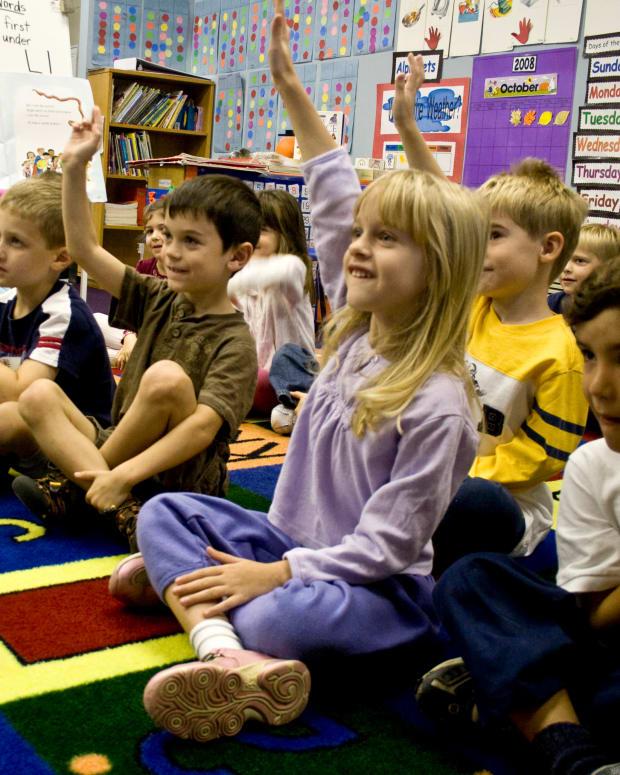School students raising hands.