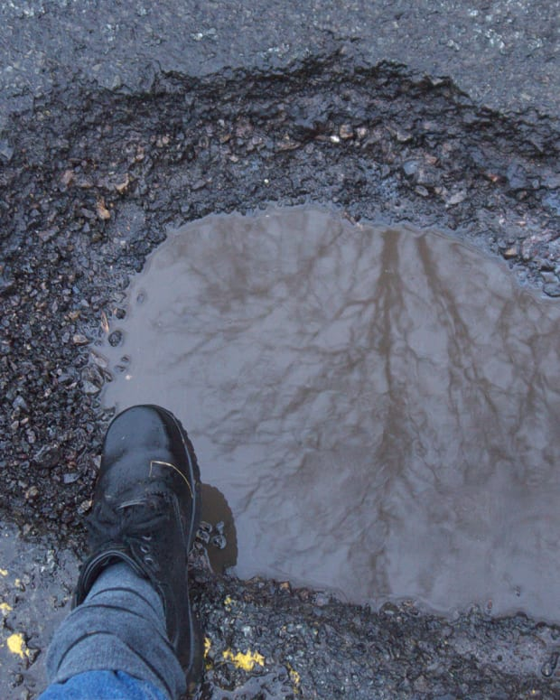 flickr-pothole-foot-boot-road-street
