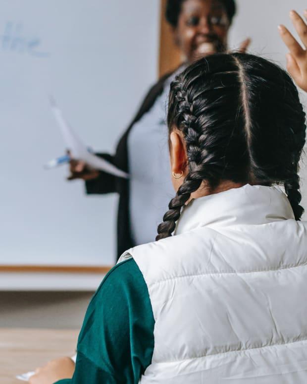 Pexels - classroom kid teacher student raise hand - crop