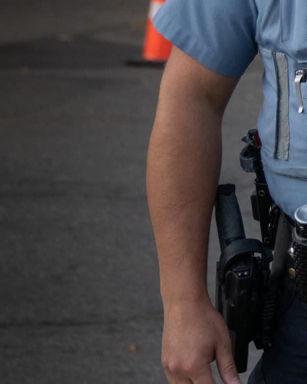 Flickr - minneapolis police officer close-up belt camera - Tony Webster