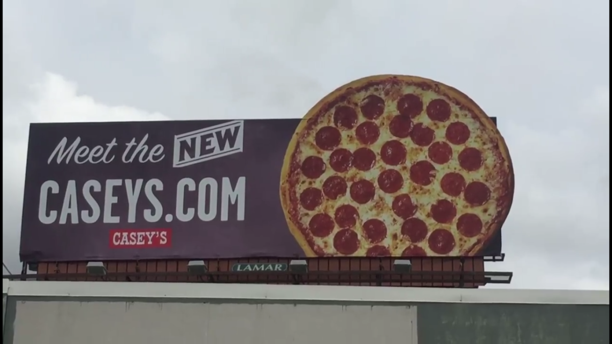 caseys-pizza-billboard-screengrab-facebook-phil-reed-kcrg