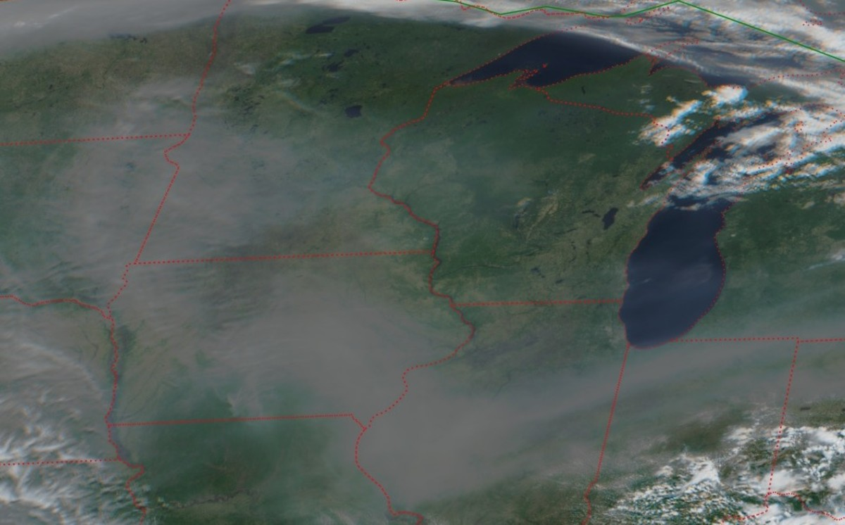 Those aren't clouds over Minnesota. It's smoke.