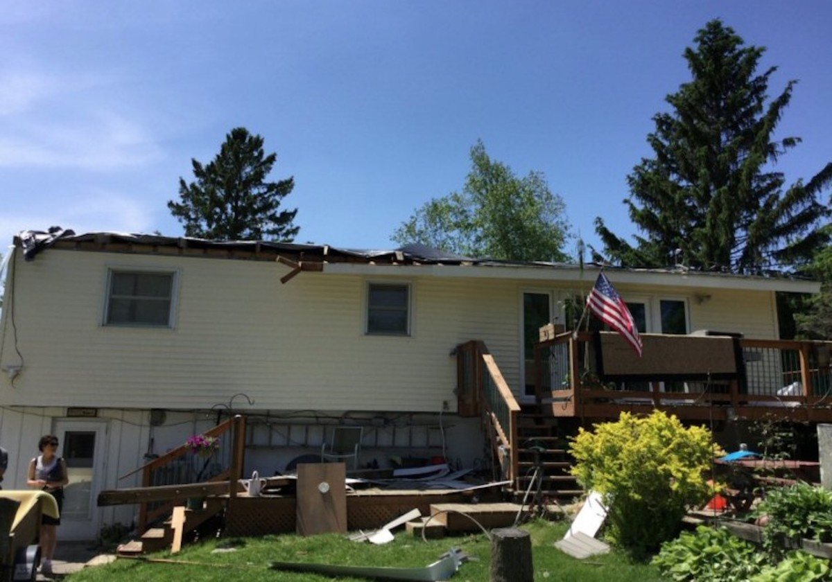 A home was badly damage, with its roof torn off, in the tornado.
