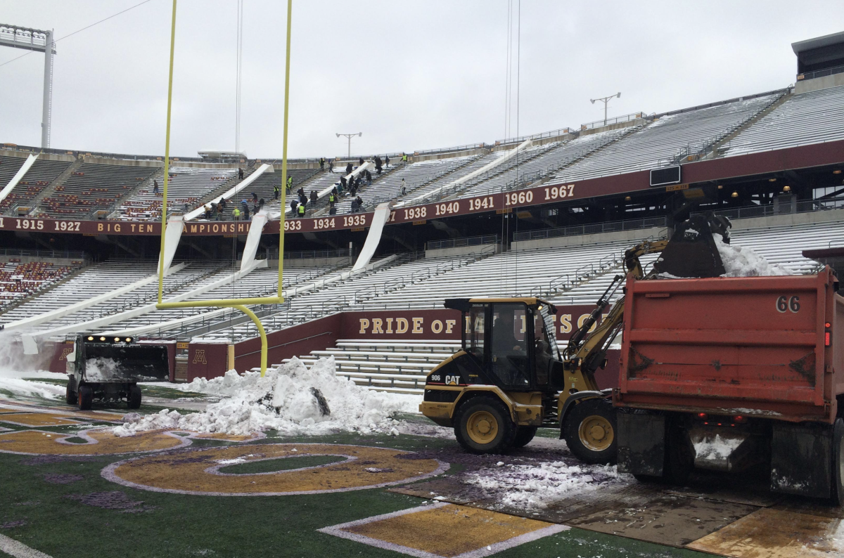 shoveling TCF Bank Stadium