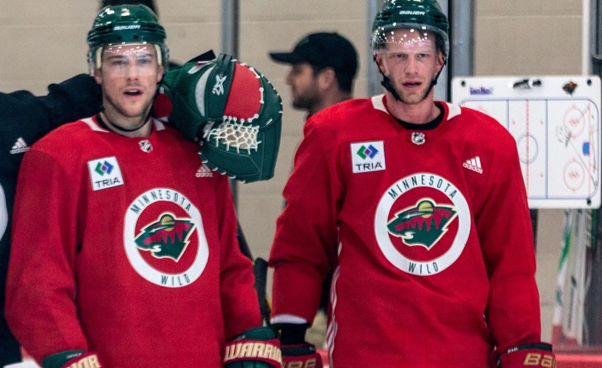 Charlie Coyle (left) with Eric Staal (right)
