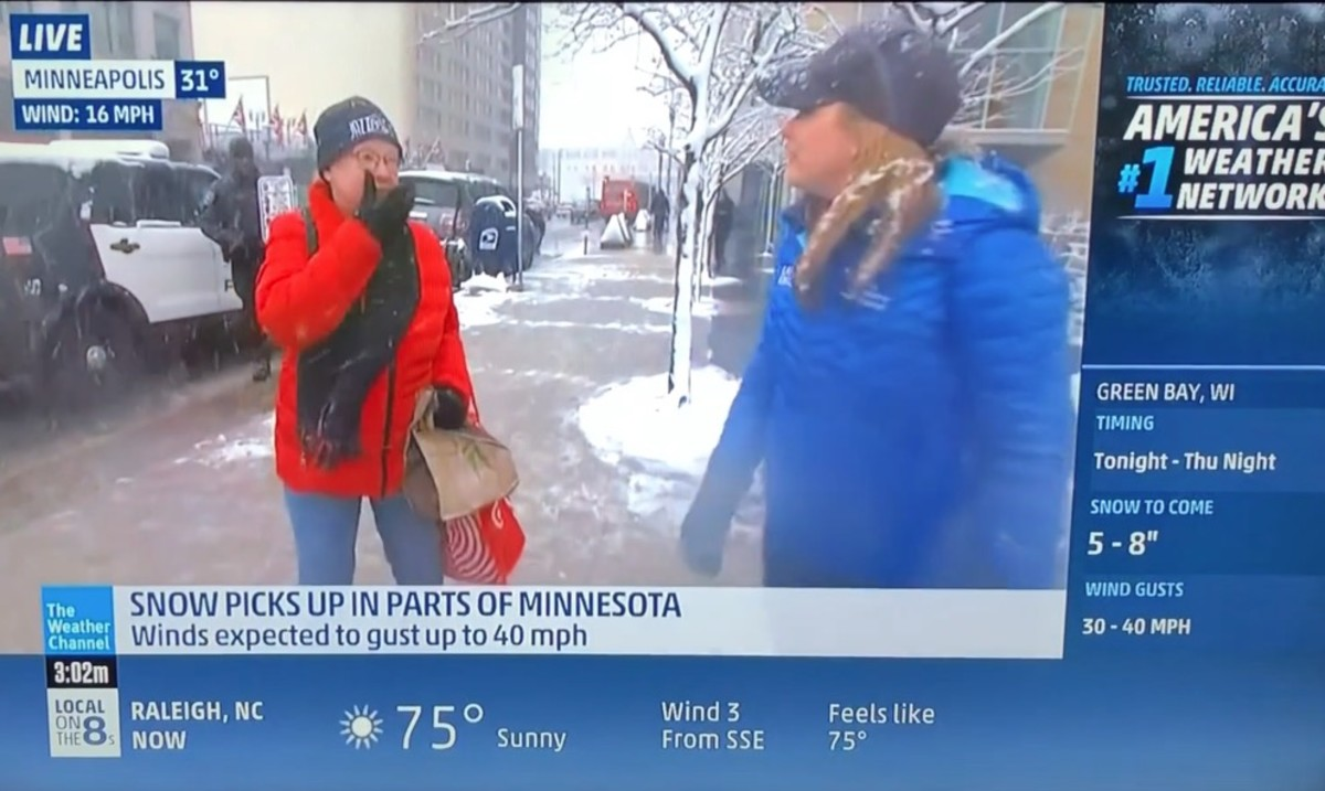 watch  minneapolis woman tells weather channel reporter