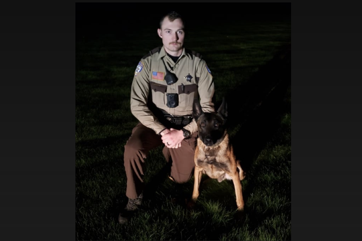 Deputy Jake Johnson and K-9 Ghost, who tracked the suspect into the swamp.
