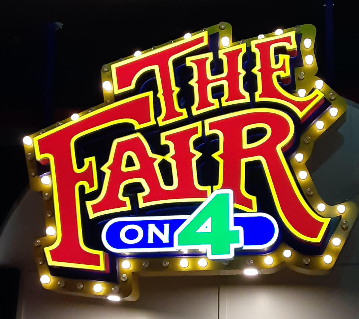 A sign for The Fair on 4.