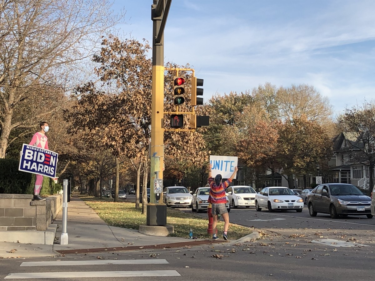 BrookeSteigauf and Ethan Hanson stood at the intersection celebrating Biden's win for hours Saturday afternoon.