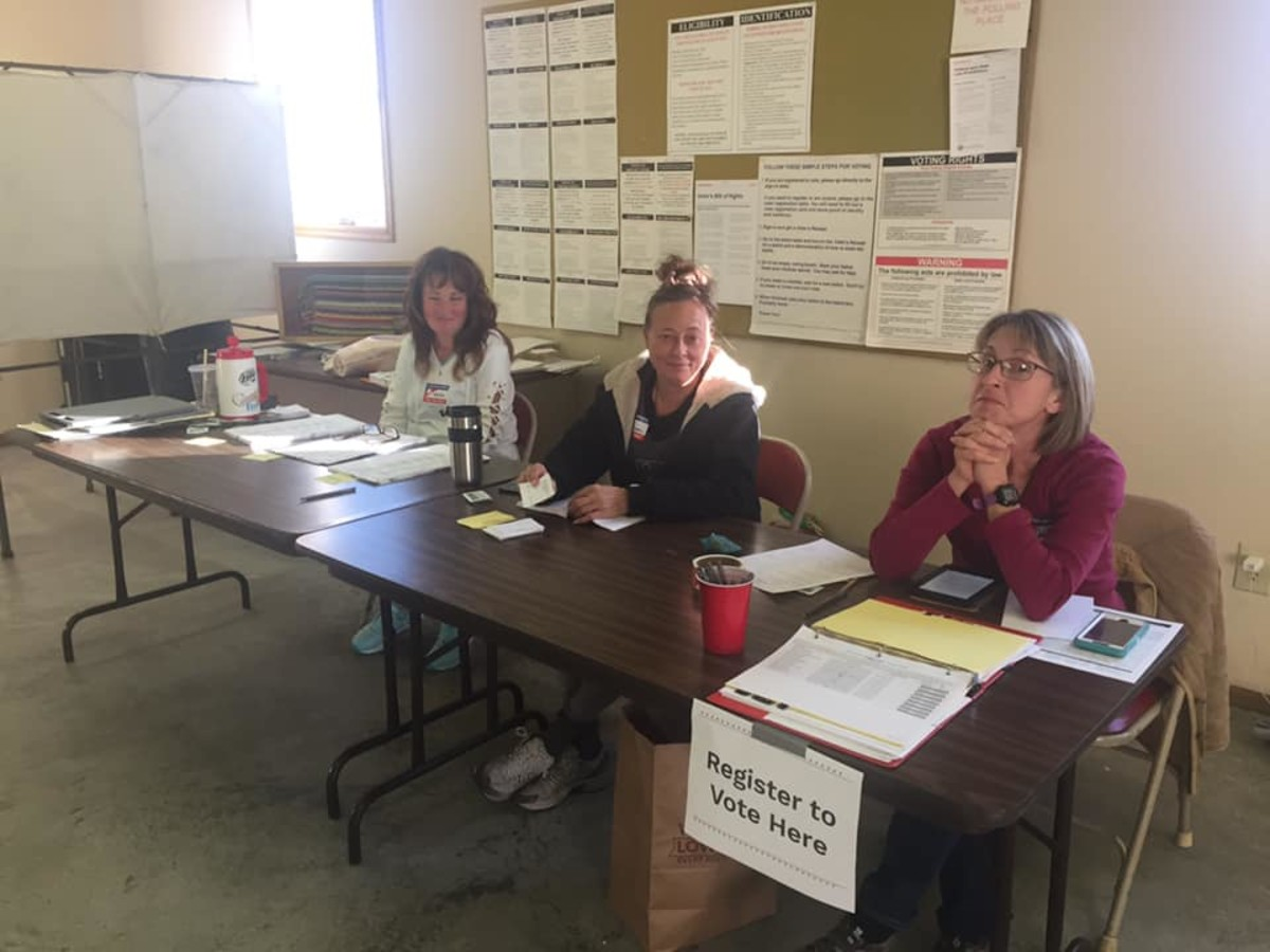 Wiscoy Township Treasurer, Dawn Kronebusch, far left, andWiscoy Township Clerk, Cassi Waldo, far right, are pictured here after voter Kaitlyn O'Connor says she asked them to wear masks because of the coronavirus pandemic.