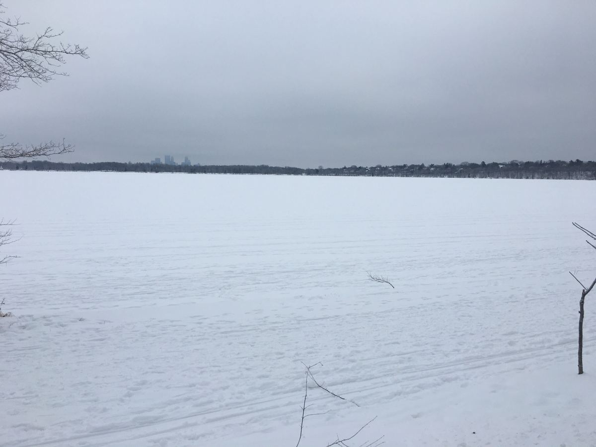 Lake Harriet covered in snow Thursday. While it appears to be mostly frozen over, snow can make it more difficult to visually gauge thickness of ice. Lakes can have patches of safe and unsafe ice close together.