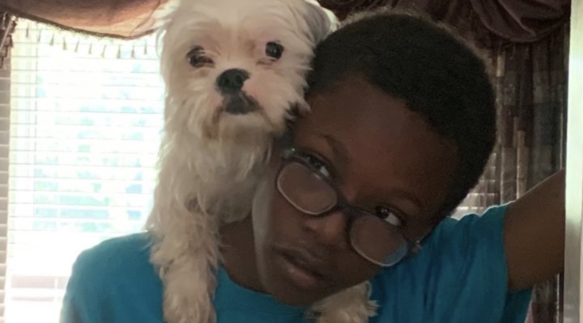 Jeylon Holloway, 13, was bringing his dog for a walk when he fell into the lake.