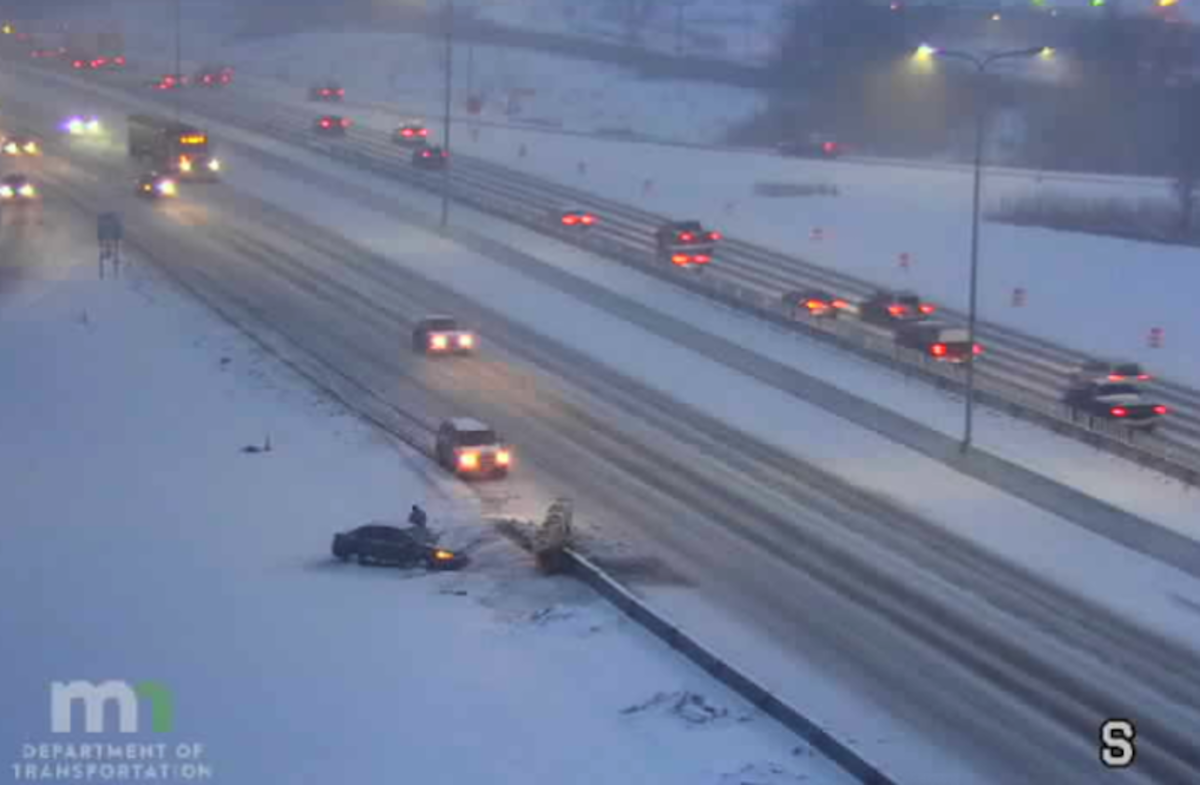 A vehicle off the road on northbound Interstate 35W near County Road D north of the Twin Cities Thursday morning.