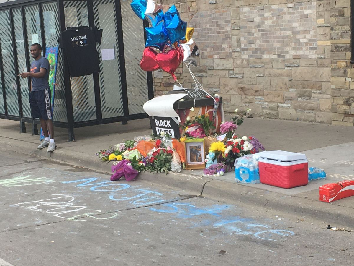Remembrances left at the site where George Floyd died after a Minneapolis police officer knelt on his neck.