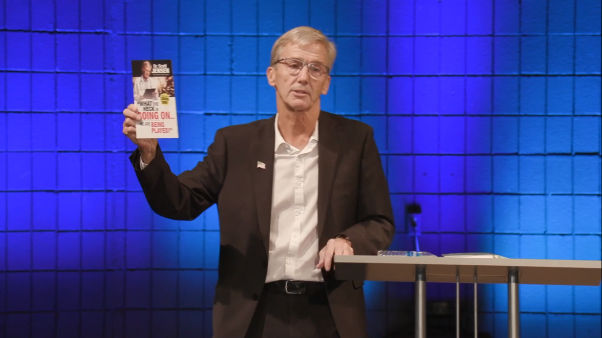 Dr. Scott Jensen, displaying a promotion for his upcoming book during the Sept. 25 conference.