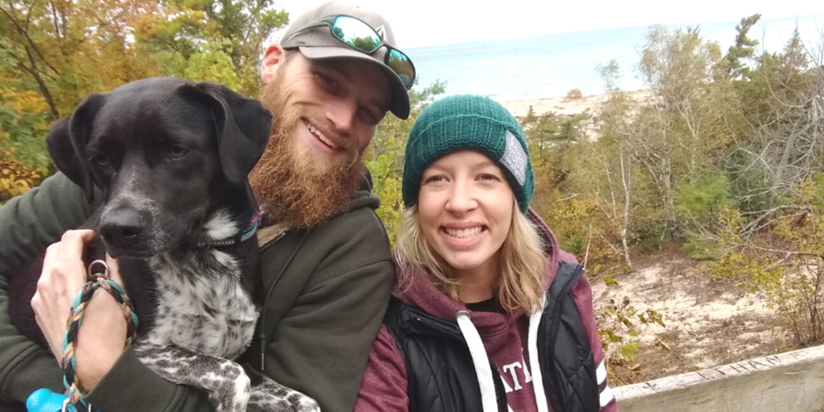 Kelly Blodgett (right) with her partner, Derek (middle) and their dog (left, obviously).