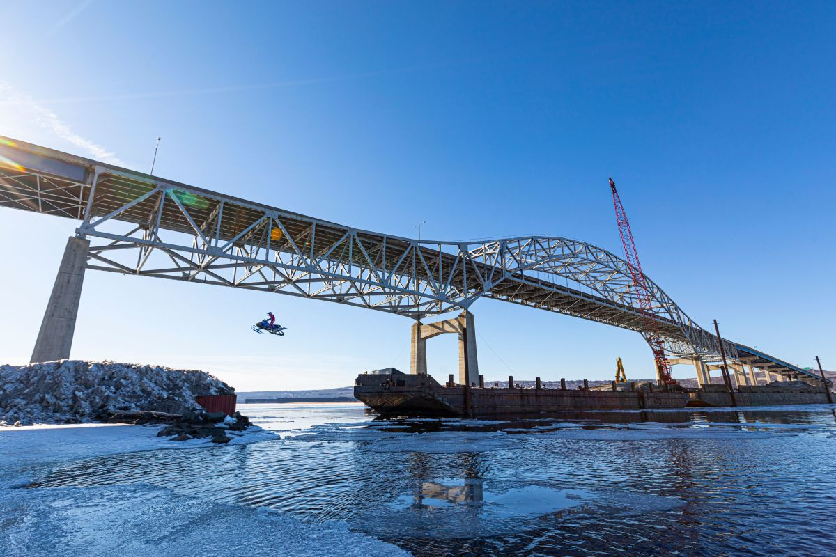 Levi LaVallee jumping from a barge under the Blatnik Bridge in March.
