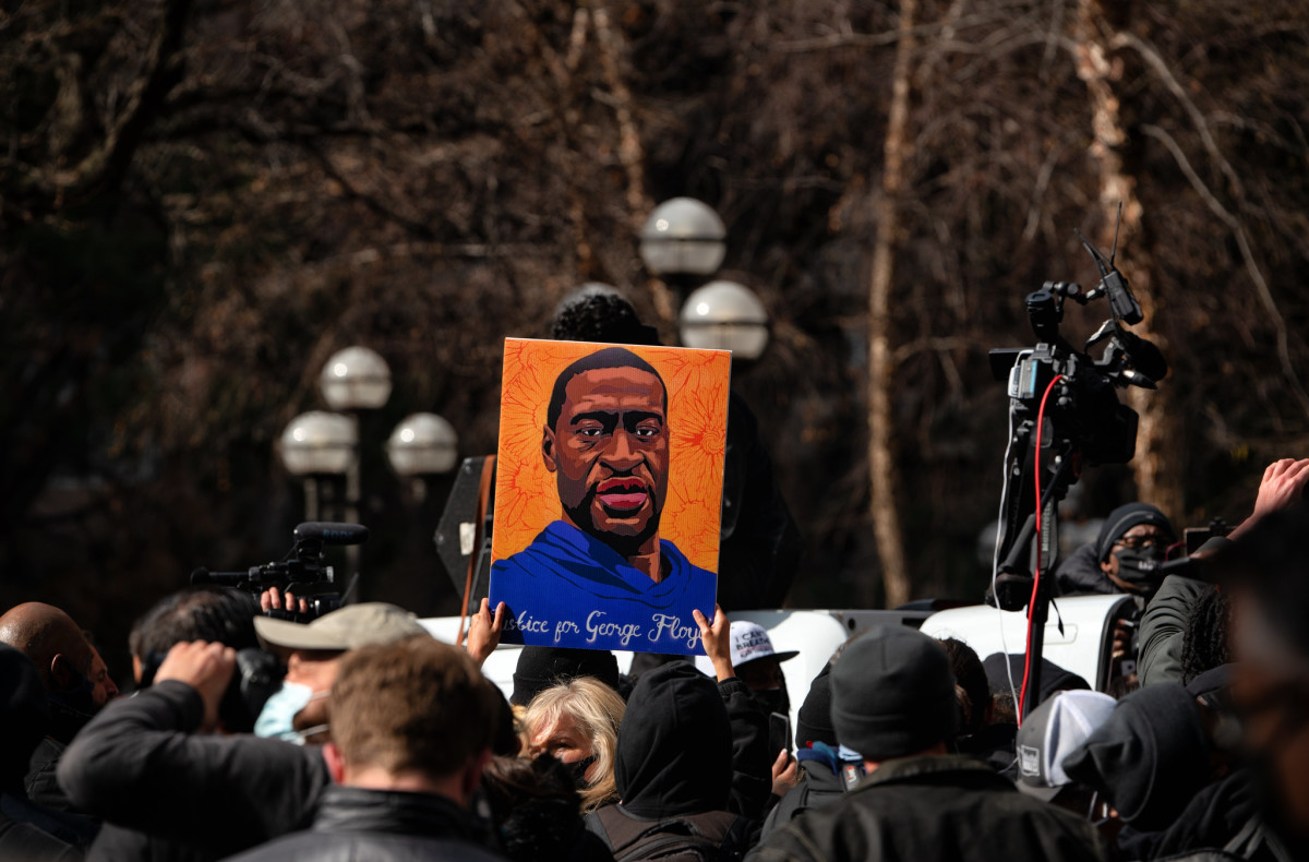 Someone holds up a George Floyd sign on April 20 in Minneapolis.