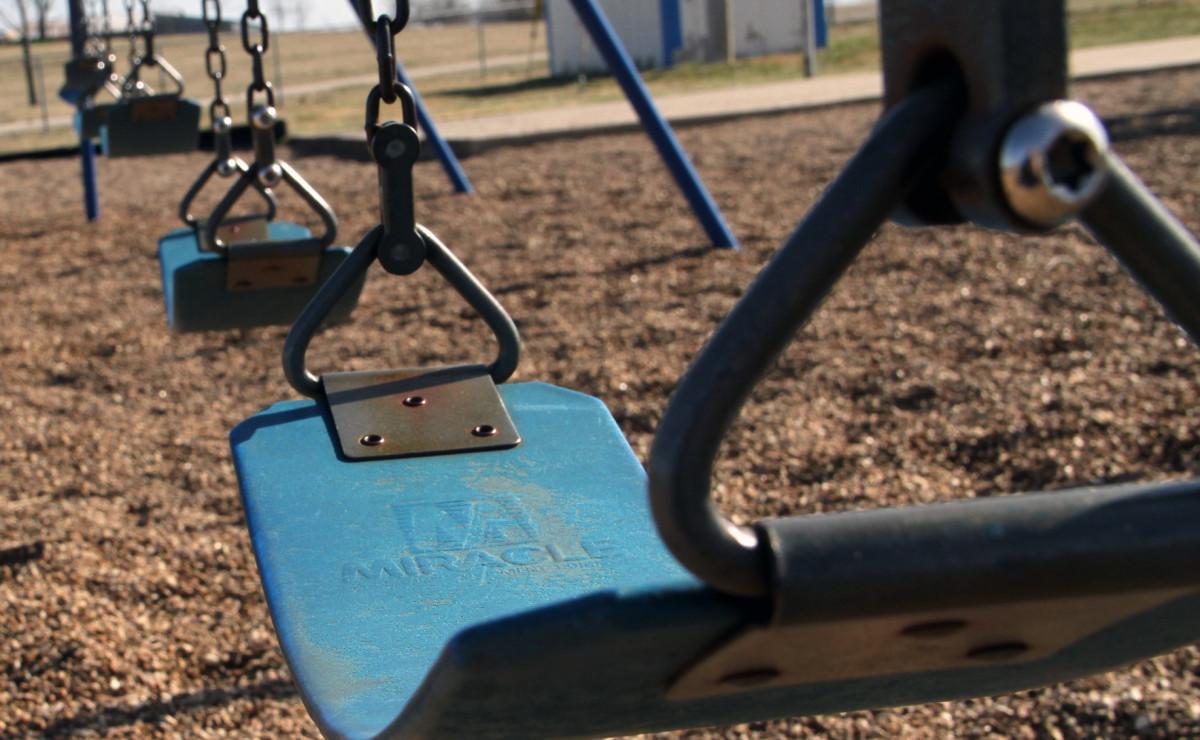 Empty playground, swings.