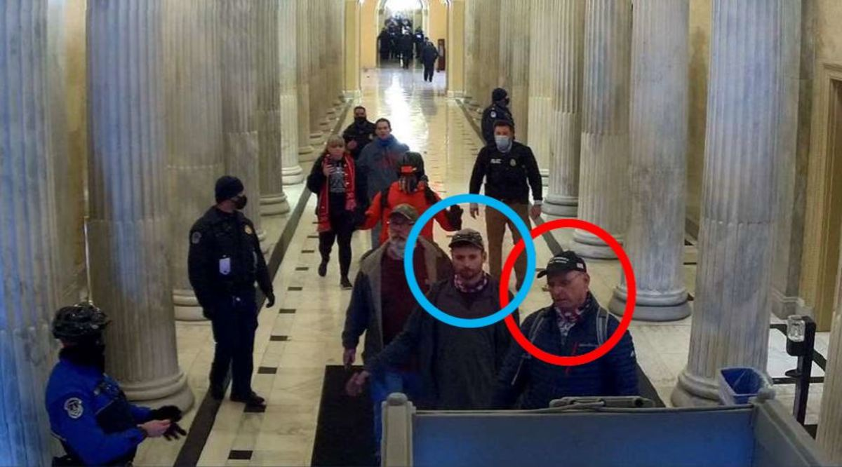 Authorities say the subjects in this photo from Jan. 6, 2021, are Daniel Johnson (blue circle) and his father Daryl Johnson (red circle).