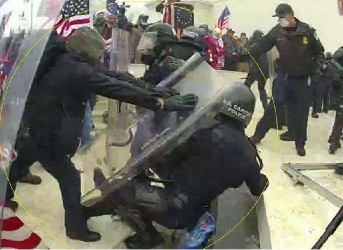 A screengrab from body camera footage, purportedly showing Brian Mock shoving a Capitol police officer to the ground.