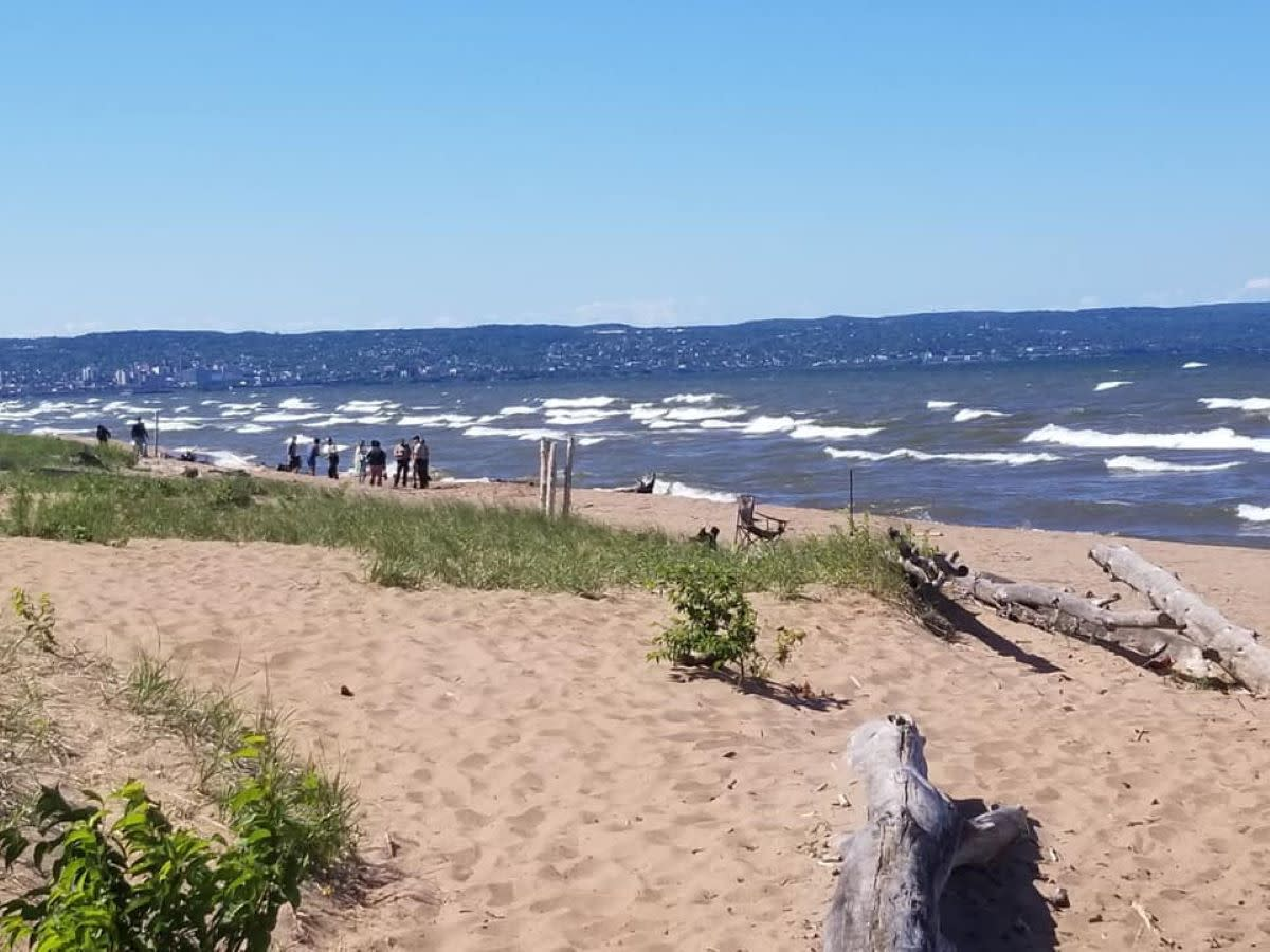 Duluth firefighters help a woman who was struggling in the water on July 1.