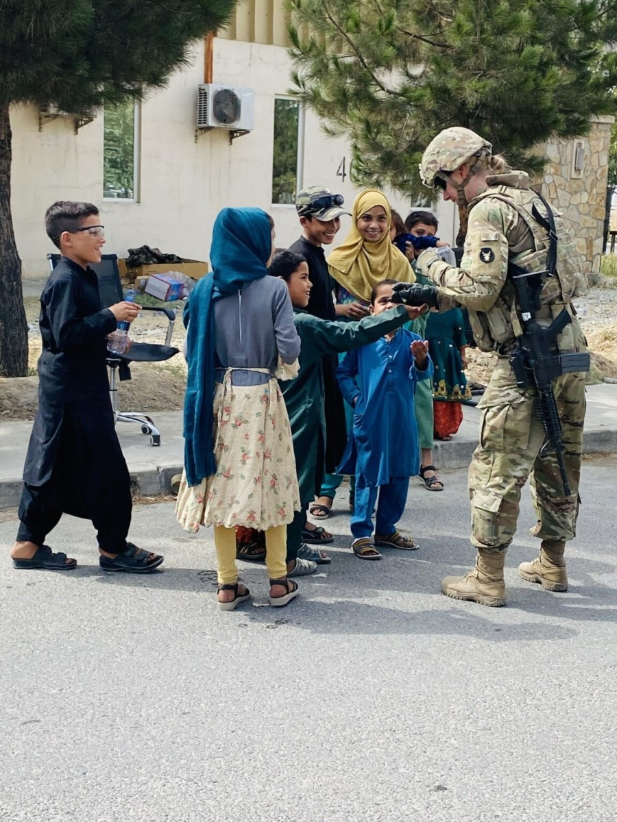 1st Lt. Michelle Jaeger interacts with Afghan childrenon Aug. 21, 2021.